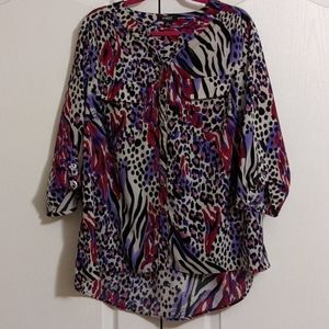 Vibrant animal print tunic with 3/4 sleeves